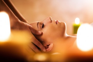 Close up of young woman receiving head massage at the spa.